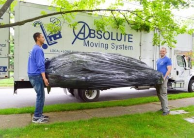 Pictured: moving professionals with a large piece of furniture.