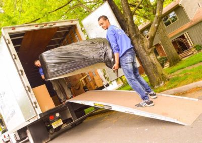 Pictured: An Absolute Moving System employee loading a moving truck.
