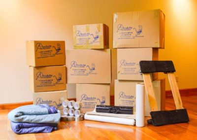 Pictured: Moving supplies such as some boxes, a furniture dolley, and furniture pads.