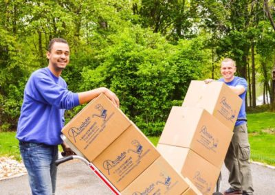 This is an image of two professional movers of Absolute Moving System.