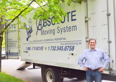 Pictured: Absolute Moving System CEO Oleg Kouznetsov with moving truck.